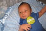 Taite at 3 weeks old, sportin' spit-up within 3 minutes of an outfit change because of spit-up;)